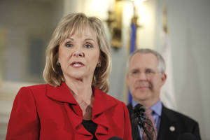 photo - Republican Gov.-elect Mary Fallin and Gov. Brad Henry hold a news conference Wednesday at the state  Capitol. Henry, a Democrat, pledged his support and resources to help Fallin in the transition. Read the story on Page 2A. Photo by David McDaniel, The Oklahoman