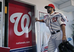 Photo - Washington Nationals pitcher Tanner Roark pauses before entering the elevator at their spring training baseball facility, Thursday, Feb. 13, 2014, in VIera, Fla. (AP Photo/Alex Brandon)