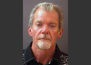 Photo - FILE - This file mug shot provided by the Hamilton County Sheriff's Department shows Indianapolis Colts owner Jim Irsay after he was arrested Sunday night, March 16, 2014. Police say Irsay had $29,000 in cash with him when he was arrested last week on suspicion of intoxicated driving.  The Indianapolis Star reports it obtained the Carmel police documents on Irsay's March 16 arrest through a public records request. (AP Photo/Hamilton County Sherriff's Department)