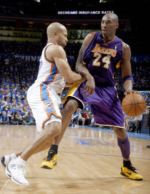 Photo - Oklahoma City's Derek Fisher (37) defends against Los Angeles' Kobe Bryant (24) during Game 1 in the second round of the NBA playoffs between the Oklahoma City Thunder and the L.A. Lakers at Chesapeake Energy Arena in Oklahoma City, Monday, May 14, 2012. Photo by Sarah Phipps, The Oklahoman