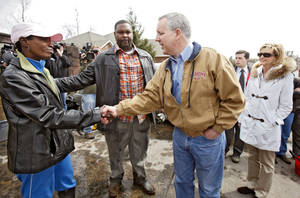 Photo - Gov. Brad Henry meets with Midwest City  residents Friday.  Photo by Chris Landsberger,  The Oklahoman