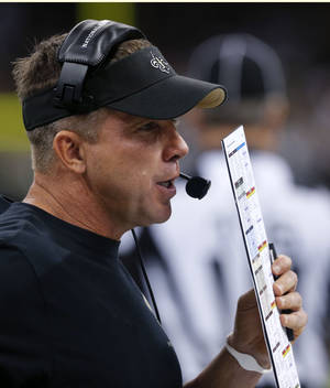 Photo - New Orleans Saints head coach Sean Payton works from the sideline in the second half of an NFL football game against the Atlanta Falcons in New Orleans, Sunday, Sept. 8, 2013. The Saints won 23-17. (AP Photo/Bill Haber)