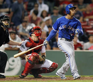 Photo -   Toronto Blue Jays' Anthony Gose, right, watches his three-run home run in front of Boston Red Sox's Ryan Lavarnway, center, in the ninth inning of a baseball game in Boston, Saturday, Sept. 8, 2012. (AP Photo/Michael Dwyer)