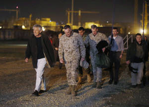 photo - Defense Secretary Chuck Hagel walks with U.S. Marine General Joseph Dunford, commander of the International Security Force, upon Hagel&#039;s arrival near Camp Eggers in Kabul, Afghanistan, Friday, March 8, 2013. Hagel arrived in Afghanistan Friday for his first visit as Pentagon chief, saying that there are plenty of challenges ahead as NATO hands over the country&#039;s security to the Afghans. (AP Photo/Jason Reed, Pool)