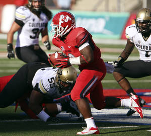 Photo -   Fresno State's Robbie Rouse rushes past Colorado defenders in the first quarter of an NCAA college football game in Fresno, Calif., Saturday, Sept. 15, 2012. (AP Photo/Gary Kazanjian)