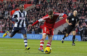 Photo - Southampton's Adam Lallana, center, scores his team's opening goal during their English Premier League soccer match against West Bromwich Albion at St Mary's, Southampton, England, Saturday, Jan, 11, 2014. (AP Photo/Chris Ison, PA Wire) UNITED KINGDOM OUT   -  NO SALES  -  NO ARCHIVES