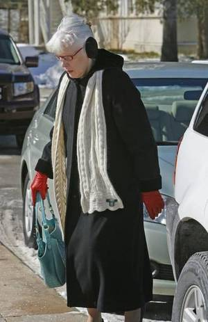 Photo - File photo - University of Oklahoma Senior Vice President and Provost walks to her office on Thursday, February 10, 2011, in Norman, Okla. Photo by Steve Sisney, The Oklahoman