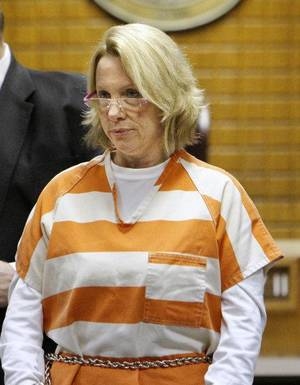 Photo - Becky Bryan, wife of slain fire chief Keith Bryan, walks into the courtroom for her initial arraignment at the Canadian County Courthouse in El Reno Friday, Sept. 30, 2011. Photo by Paul B. Southerland, The Oklahoman ORG XMIT: KOD