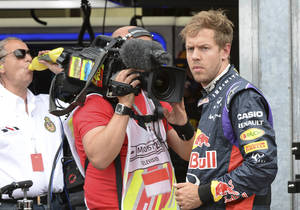 Photo - Red Bull driver Sebastian Vettel of Germany watches after he backs to the pits after failing to complete the Monaco Formula One Grand Prix, at the Monaco racetrack, in Monaco, Sunday, May 25, 2014. (AP/hoto/Boris Hovat/ Pool)