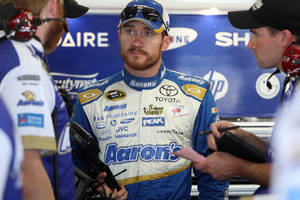 Photo - Brian Vickers talks with his crew after the morning practice for Sunday's Sprint Cup Series auto race at New Hampshire Motor Speedway, Saturday, July 12, 2014 in Loudon, N.H. (AP Photo/Jim Cole)
