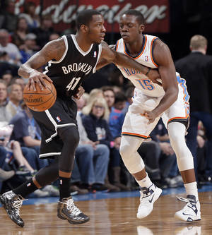 Photo - Oklahoma City's Reggie Jackson (15) defends on Brooklyn Nets' Tyshawn Taylor (41) during the NBA basketball game between the Oklahoma City Thunder and the Brooklyn Nets at the Chesapeake Energy Arena on Wednesday, Jan. 2, 2013, in Oklahoma City, Okla. Photo by Chris Landsberger, The Oklahoman