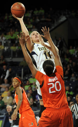 Photo - Notre Dame forward Natalie Achonwa puts a shot up over Miami forward Keyona Hayes during the first half of an NCAA college basketball game, Thursday, Jan. 23, 2014 in South Bend, Ind. (AP Photo/Joe Raymond)