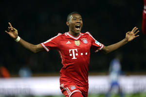 Photo - Bayern's David Alaba of Austria celebrates his team's opening goal scored by Toni Kroos during  the German Bundesliga soccer match between Hertha BSC Berlin and Bayern Munich in Berlin, Germany, Tuesday, March 25, 2014. (AP Photo/Michael Sohn)