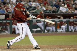 Photo - Arizona Diamondbacks' Aaron Hill connects for a home run off Washington Nationals' Doug Fister during the fourth inning of a baseball game Wednesday, May 14, 2014, in Phoenix. (AP Photo)