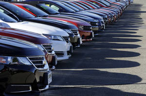 Photo - In this Wednesday, Sept. 18, 2013 photo Chevrolet passenger cars form a row on a dealer's lot in Needham, Mass. U.S. auto sales for September are released on Tuesday, Oct. 1, 2013. (AP Photo/Steven Senne_