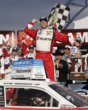Photo - Sam Hornish Jr. celebrates in Victory Lane after winning the NASCAR Nationwide Series auto race, Saturday, March 9, 2013, in Las Vegas. (AP Photo/Julie Jacobson)