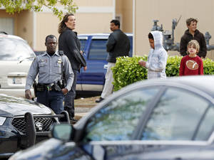 Photo - Oklahoma City police respond to a call Thursday at Willow Cliff Apartments, 5304 Willow Cliff Road.  Photo by Nate Billings, The Oklahoman