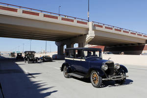 Photo - Antique cars cross under the Western Ave. bridge on Thursday during grand opening ceremonies for the eastbound lanes of the Interstate 40 Crosstown in Oklahoma City. Photo by Paul B. Southerland, The Oklahoman