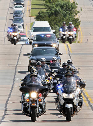 Photo - A funeral procession led by law enforcement officers accompanies a hearse carrying Jeffery Matthew McCoy's body to Sunset Memorial Park cemetery. PHOTO BY STEVE SISNEY, THE OKLAHOMAN <strong>STEVE SISNEY</strong>