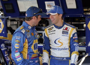 photo -   Martin Truex Jr., left, talks with Brad Keselowski in the garage during practice for Sunday's NASCAR Sprint Cup Series auto race at Michigan International Speedway Saturday, Aug. 18, 2012, in Brooklyn, Mich. AP Photo/Bob Brodbeck)