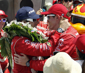 Photo - Dario Franchitti, left, of Scotland, is congratulated by Scott Dixon, of New Zealand, after Franchitti won IndyCar's Indianapolis 500 auto race at Indianapolis Motor Speedway in Indianapolis, Sunday, May 27, 2012. (AP Photo/Tom Strattman) ORG XMIT: NAA158