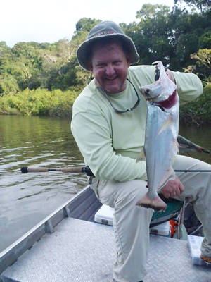 photo - Kenyon Hill holds up a payara he caught on the Amazon River. PHOTO PROVIDED