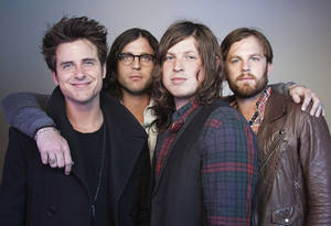 Photo -   FILE - In this Oct. 21, 2010 file photo, members of the band Kings of Leon, from left, Jared Followill, Nathan Followill, Matthew Followill and Caleb Followill, pose for a portrait in New York. The Kings of Leon promised Sunday, July 31, 2011, to make it up to their Dallas fans after they canceled a show when their lead singer complained it was too hot to perform. In a statement, the band announced plans to return to Dallas on Sept. 21. (AP Photo/Victoria Will, File)