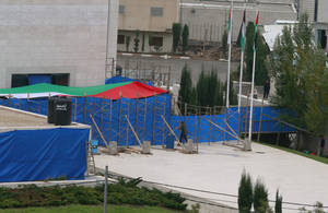 Photo -   Blue tarp covers the entrance to Yasser Arafat's mausoleum in the West Bank city of Ramallah. The remains of the late Palestinian leader Yasser Arafat were exhumed from his grave on Tuesday so international forensic experts could search for additional clues to his death, Palestinian officials said. (AP Photo/Nasser Shiyoukhi)