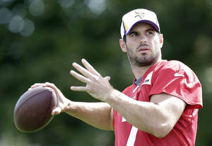 Photo - Minnesota Vikings quarterback Christian Ponder throws a pass during NFL football training camp, Monday, July 29, 2013, in Mankato, Minn. (AP Photo/Charlie Neibergall)