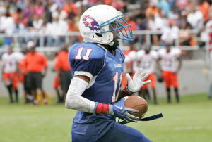 photo -  Millwood's Josh Turner scores a touchdown during the Soul Bowl game against Douglass at Millwood High School in Oklahoma City, Oklahoma September 12, 2009. Photo by Steve Gooch, The Oklahoman