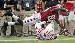 photo -   Alabama wide receiver Kevin Norwood (83) dives over the tackle of Western Kentucky defensive back Arius Wright (21) in the first quarter of an NCAA college football game at Bryant Denny Stadium in Tuscaloosa, Ala., Saturday, Sept. 8, 2012. (AP Photo/Dave Martin)