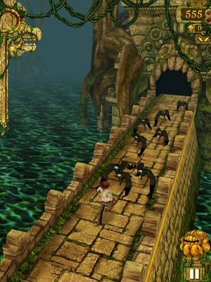 "Photo - In the mobile application ""Temple Run,"" alien monkeylike creatures chase the running hero out of the temple after he (or she) steals an artifact, depicted here in this screen shot from the game."
