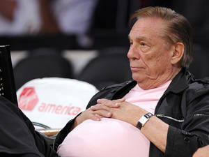 Photo - FILE - In this Oct. 17, 2010 file photo, Los Angeles Clippers team owner Donald Sterling watches his team play in Los Angeles. Sterling has pulled his support from a deal to sell the team to former Microsoft CEO Steve Ballmer and will pursue his $1 billion federal lawsuit against the NBA, his attorney said Monday, June 9, 2014. (AP Photo/Mark J. Terrill, File)