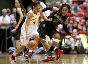 Photo - Baylor guard Odyssey Sims tries to work through a screen as she defends Iowa State guard Nikki Moody during the second half of an NCAA college basketball game in Ames, Iowa, Tuesday, March 4, 2014. Baylor won 70-54. (AP Photo/Justin Hayworth)