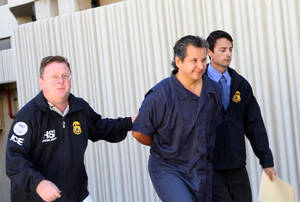 photo -   FILE - Marco Antonio Delgado is escorted out of the El Paso County Jail, in this Nov. 5, 2012 file photo taken in El Paso, Texas. Delgado will have his detention hearing in federal court in El Paso, Texas Wednesday Nov. 14, 2012. (AP Photo/Juan Carlos Llorca, File)