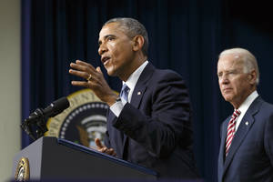 Photo - President Barack Obama, joined by Vice President Joe Biden, right, speaks before signing the Workforce Innovation and Opportunity Act, bipartisan job-training legislation which aims to help job seekers gain valuable employment skills, at the Eisenhower Executive Office Building in the White House complex in Washington, Tuesday, July 22, 2014. (AP Photo/J. Scott Applewhite)