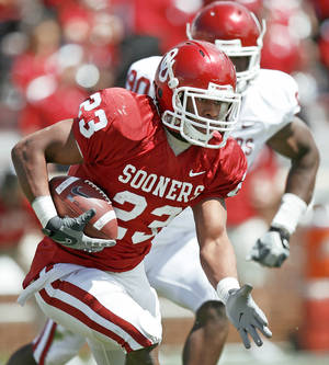 Photo - Jermie Calhoun saw a lot of action during Saturday's scrimmage. Photo By Bryan Terry, The Oklahoman