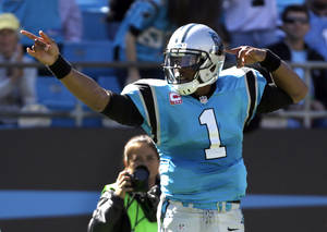Photo - Carolina Panthers' Cam Newton (1) celebrates after running for a first down against the St. Louis Rams in the first half of an NFL football game in Charlotte, N.C., Sunday, Oct. 20, 2013. (AP Photo/Bob Leverone)