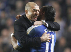 Photo -   FILE - In this Wednesday, March 14, 2012 file photo, Chelsea's manager Roberto Di Matteo, left, celebrates their win through to the next round against Napoli with Didier Drogba at the end of their Champions League last sixteen second leg soccer match at Stamford Bridge, London. Chelsea has fired coach Roberto Di Matteo, Wednesday, Nov. 21, 2012, one day after another loss in the Champions League has left the team on the brink of elimination. (AP Photo/Lefteris Pitarakis, File)