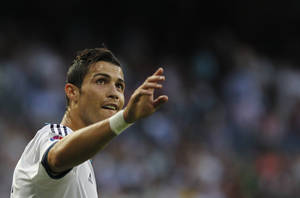 Photo -   Real Madrid's Cristiano Ronaldo from Portugal celebrates his goal during a Spanish La Liga soccer match against Granada at the Santiago Bernabeu stadium in Madrid, Spain, Sunday, Sept. 2, 2012. (AP Photo/Andres Kudacki)