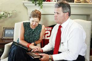 photo - Gail and Craig Box discus the loss of their son, OU football player Austin Box, at their home in Enid, Monday, July 11, 2011. The photo is from a trip to St. Louis that the dad a son had returned from less then 24 hours before his death. Photo by David McDaniel, The Oklahoman  ORG XMIT: KOD