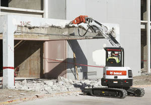 Photo - Demolition was under way Friday in preparation for renovation of the former Lincoln Plaza Hotel, 4345 N Lincoln Blvd., for use by Oklahoma Health Care Authority. Photos by PAUL HELLSTERN, The Oklahoman