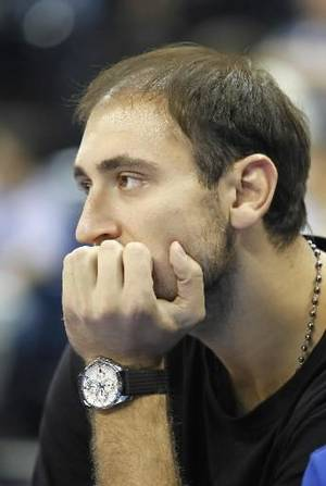 Photo - Serbia's player Nenad  Krstic  watches his team before a friendly basketball match Serbia against China, in Belgrade, Serbia, Sunday, Aug. 22, 2010.(AP Photo/Darko Vojinovic)