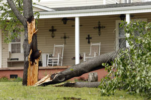 Photo - Wind damage from the previous night's severe thunderstorms is evident on Thursday in Purcell. (Photo by Steve Sisney, The Oklahoman)