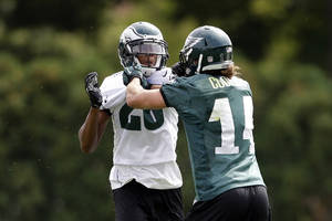 Photo - Philadelphia Eagles cornerback Cary Williams, left, and Riley Cooper push each other during practice at the NFL football team's training facility, Thursday, Sept. 5, 2013, in Philadelphia. (AP Photo/Matt Rourke)