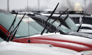 photo - Wipers are left up and away from windshields in a parking lot near Britton Rd. and May Ave. during a winter storm in Oklahoma City, Thursday, January 28, 2010. Photo by Nate Billings, The Oklahoman
