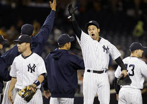 Photo -   New York Yankees right fielder Nick Swisher, center, celebrates with teammates after their 10-7 win over the Toronto Blue Jays in their baseball game at Yankee Stadium in New York, Thursday, Sept. 20, 2012. (AP Photo/Kathy Willens)