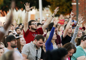 Photo - People react as Christian recording artist Charlie Hall performs during a street party to preview the FeedOKCNow initiative by the CIty Rescue Mission in downtown Oklahoma City, Monday, Sept. 10, 2012. Photo by Nate Billings, The Oklahoman