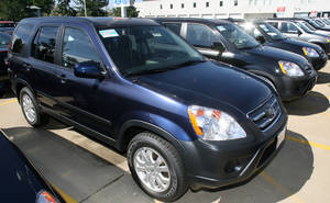 photo -   In this Aug. 20, 2006 photo, a long line of unsold 2006 Honda CRVs sits on the lot of a Honda dealership in the south Denver suburb of Littleton, Colo. Honda Motor Co. is recalling CR-V crossovers from the 2002 to 2006 model years because an electrical switch in the driver&#039;s side door could melt and cause a fire. Honda and the National Highway Traffic Safety Administration announced the recall Saturday, Oct. 6, 2012. (AP Photo/David Zalubowski)  