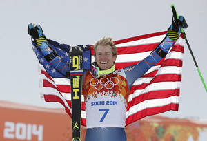 Photo - Men's giant slalom gold medalist Ted Ligety of the United States poses for photographers  on the podium at the Sochi 2014 Winter Olympics, Wednesday, Feb. 19, 2014, in Krasnaya Polyana, Russia. (AP Photo/Christophe Ena)